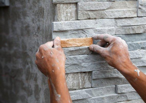 Облицовка фасада натуральным камнем: технология
